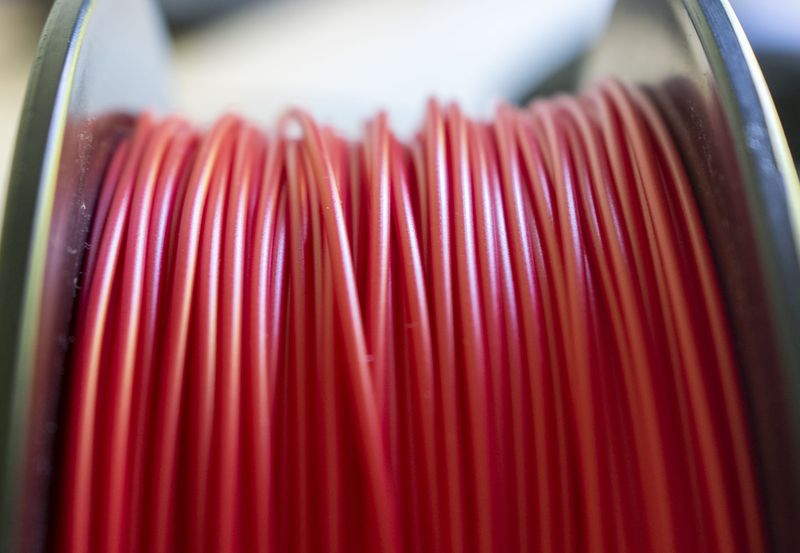 Geeetech Red PLA Filament Strands Close Up